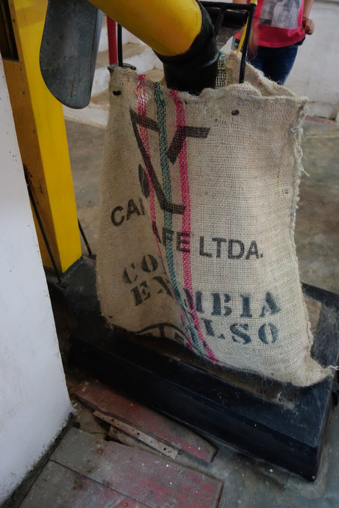 Gravity coffee bean bag filler